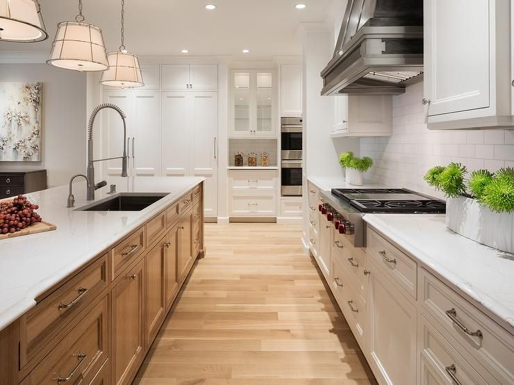 Two Tone Kitchen Island Butcher Block Table Toned Featuring Oak Cabinetry And White Marble Countertops With A Beveled Edge