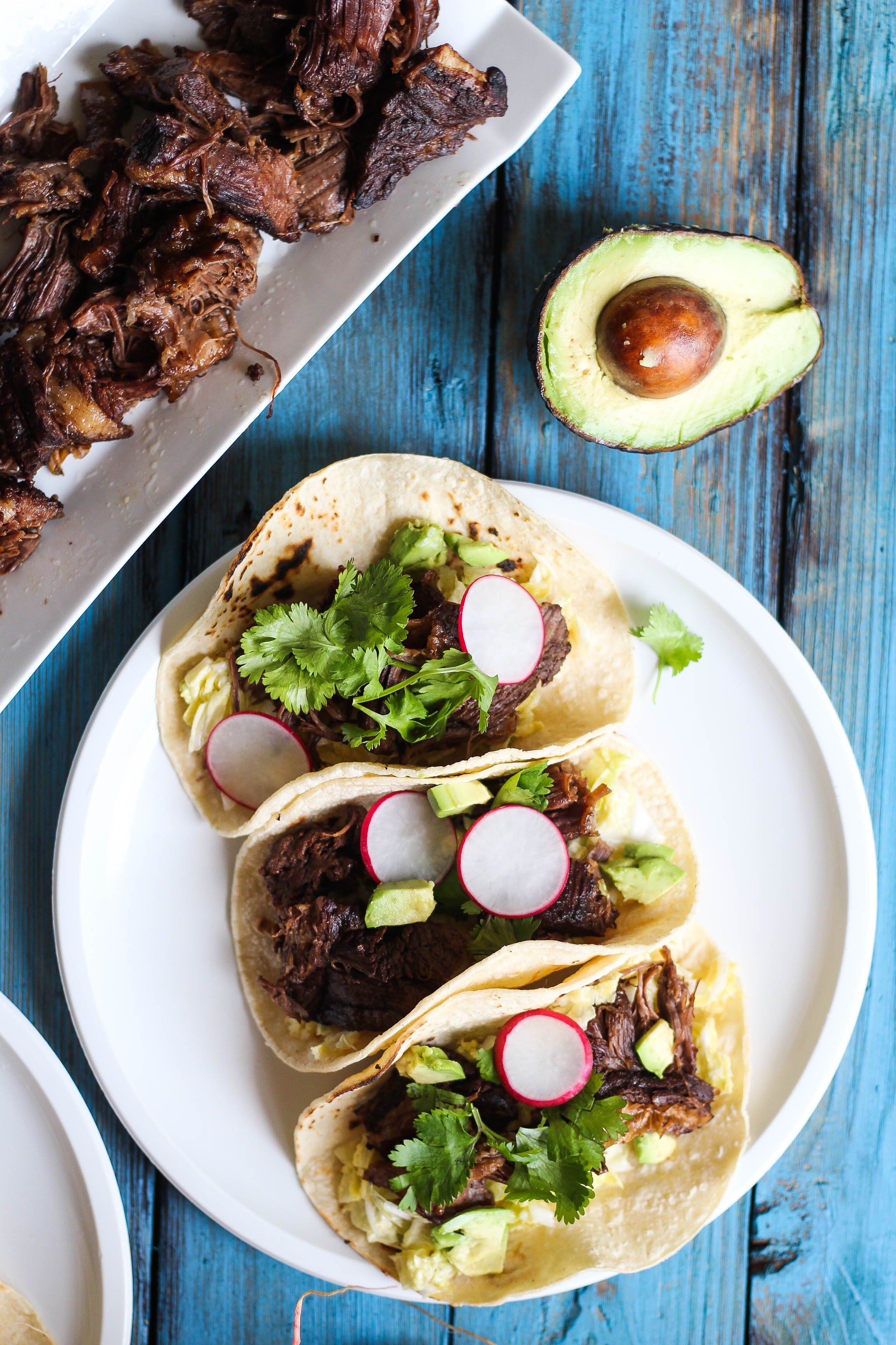 Slow-cooked beef short ribs in an Asian-inspired marinade are a fun twist on a Mexican classic. Enjoy a unique marriage of textures in these simple, wholesome tacos.