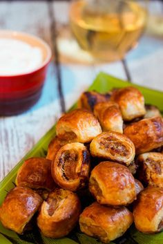 Spicy Sausage Rolls. Sausage wrapped up in puff pastry with a spicy dipping sauce - a great addition to any party or for the upcoming big game