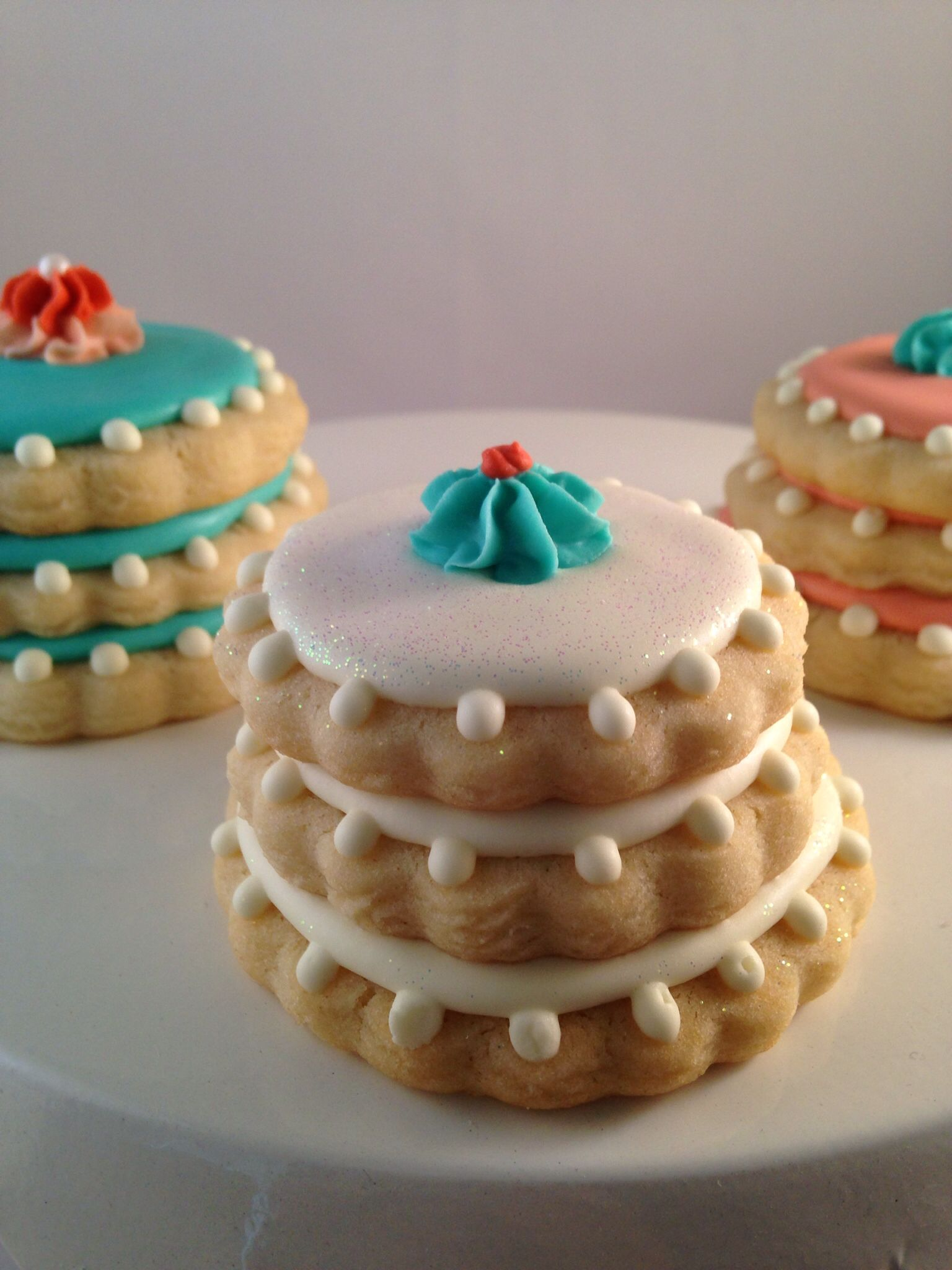 White royal icing stacked sugar cookie with edible glitter