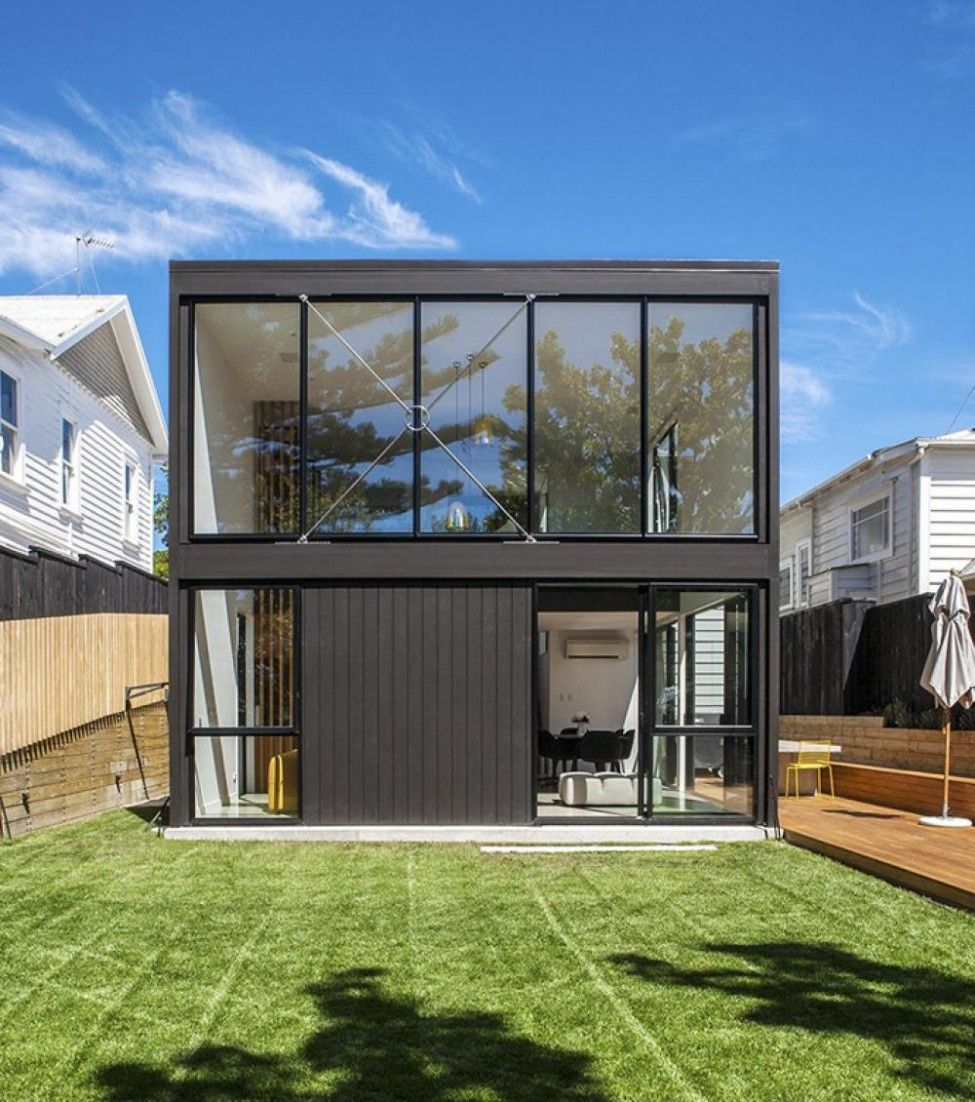 Two Storey Box Shaped Black Facade With Gloss Black Trim Allows The ...