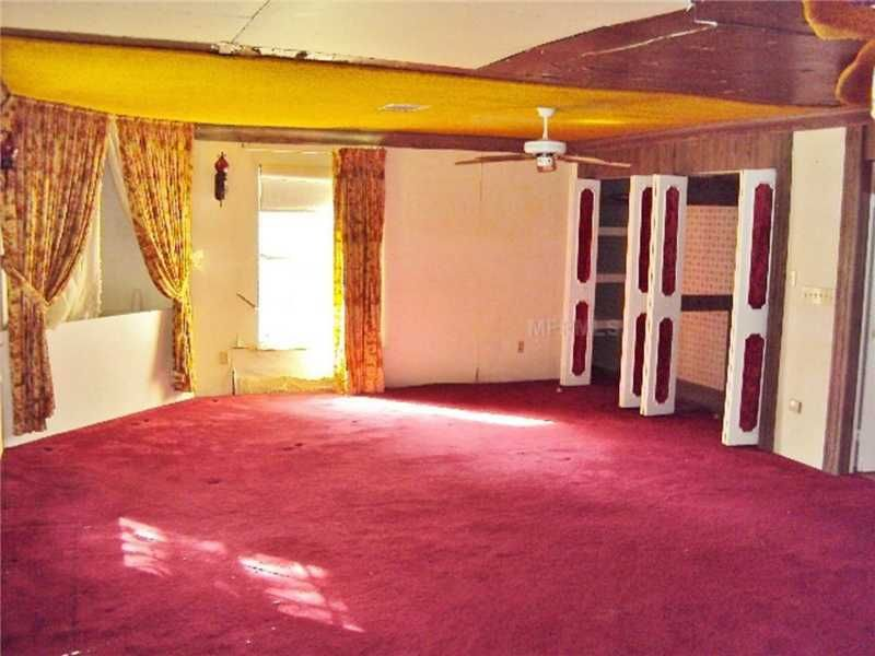 outdated ugly décor red carpet bedroom drapes damaged ceiling dade