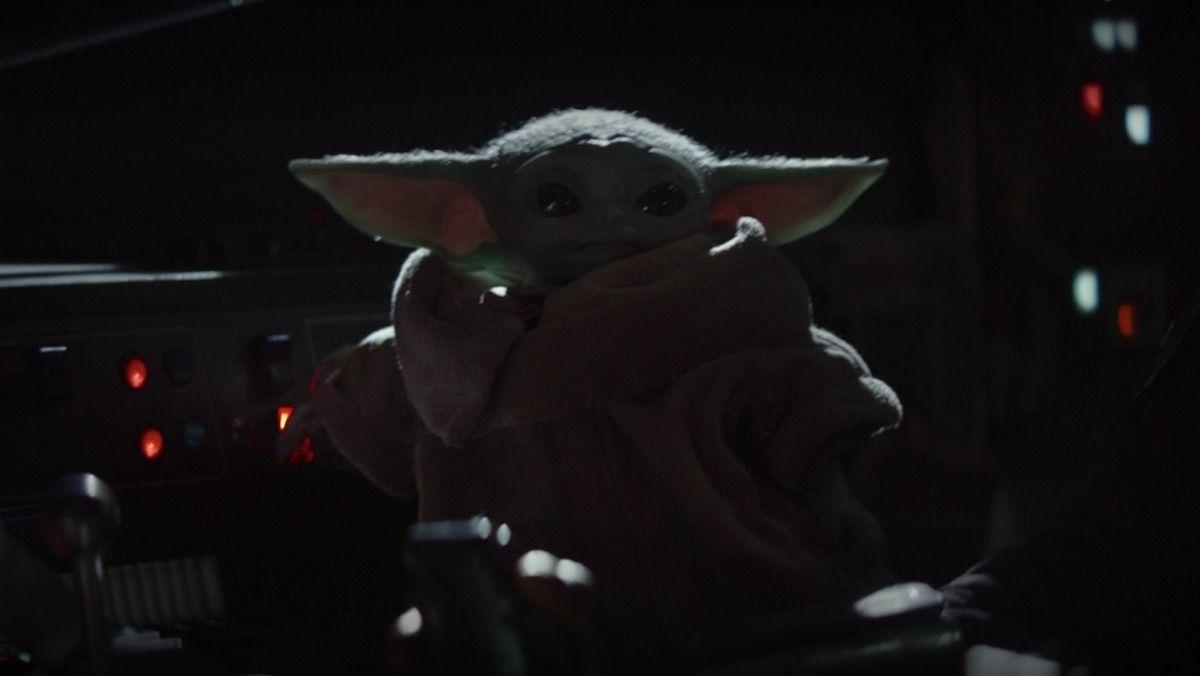 Baby Yoda Playing With The Radio Is The Best Meme In The Galaxy Nerdist Yoda Meme Mandalorian Star Wars Memes