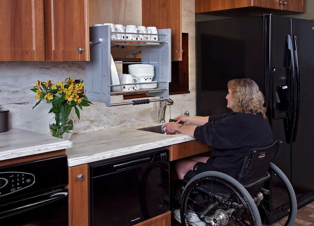 ... Kitchen Features A Lower Than Normal Countertop With Space Left Open  Below The Sink To Roll The Chair Underneath. The Cabinet Above Features Pull  Down ...