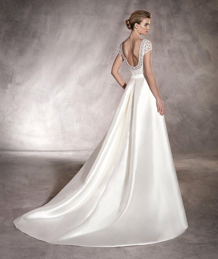 atalaya - vestido de novia entramado de pedrería en mangas y espalda