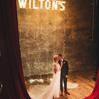 Emma and Matt and their ridiculously gorgeous and atmospheric Wiltons Music Hall Wedding. Emma wore a Pronovias dress with long draped sleeves and we just love this whole thing SO much. ⠀⠀⠀⠀ LINK IN BIO ⠀⠀⠀⠀ Photographer @nikkivandermolen Film, Irene Piera Films Stylist @forthelove_of_weddings Venue @wiltonsmusichall Wedding Dress @pronovias Headpiece @dolecka_bridal via @mirrormirrorbridalcouture Shoes @harrietwildeshoes Groom @wellsuitedltd Bridesmaid @reiss Florist @petal_hq Cake @jenscakery