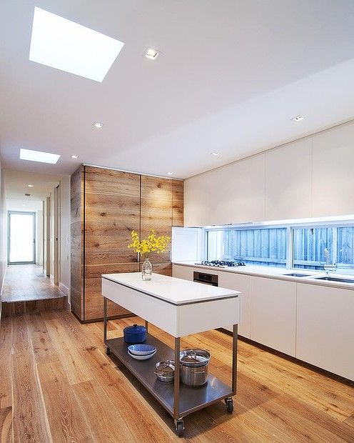 Pale, Wide Oak-veneered Boards Throughout The Kitchen And