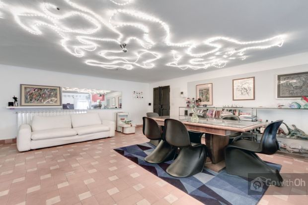Designer loft #apartment in the beautiful Trastevere district, in #Rome. It includes a decorative fireplace, wooden staircases that lead to the attic, and a living room of 70m2 with designer decoration. #GowithOhApartments