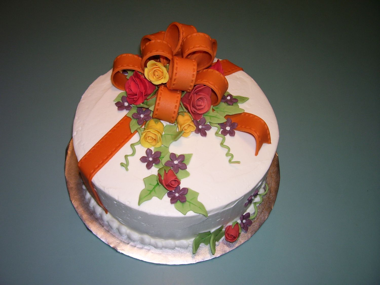 Fall Colors A birthday cake done with flowers in fall colors