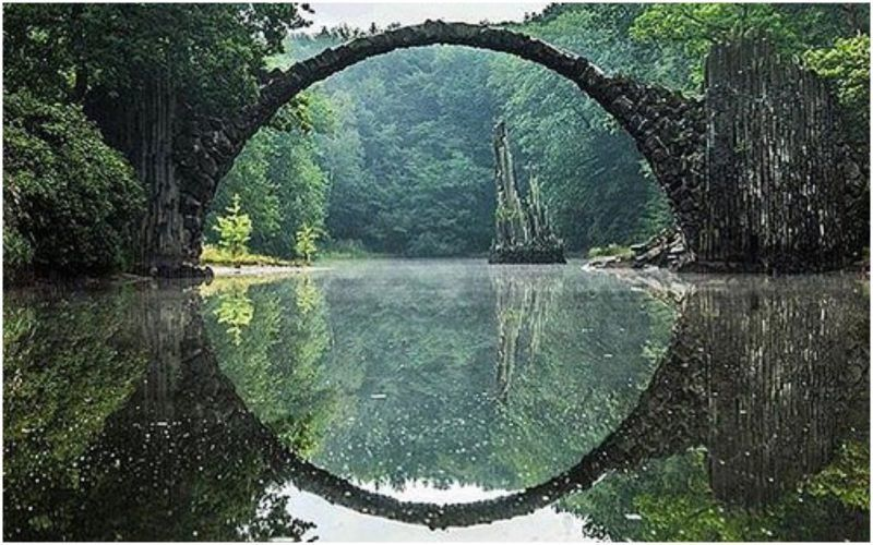 The Devils Bridge in Germanys Kromlau Park is designed to reflect a perfect circle in the water