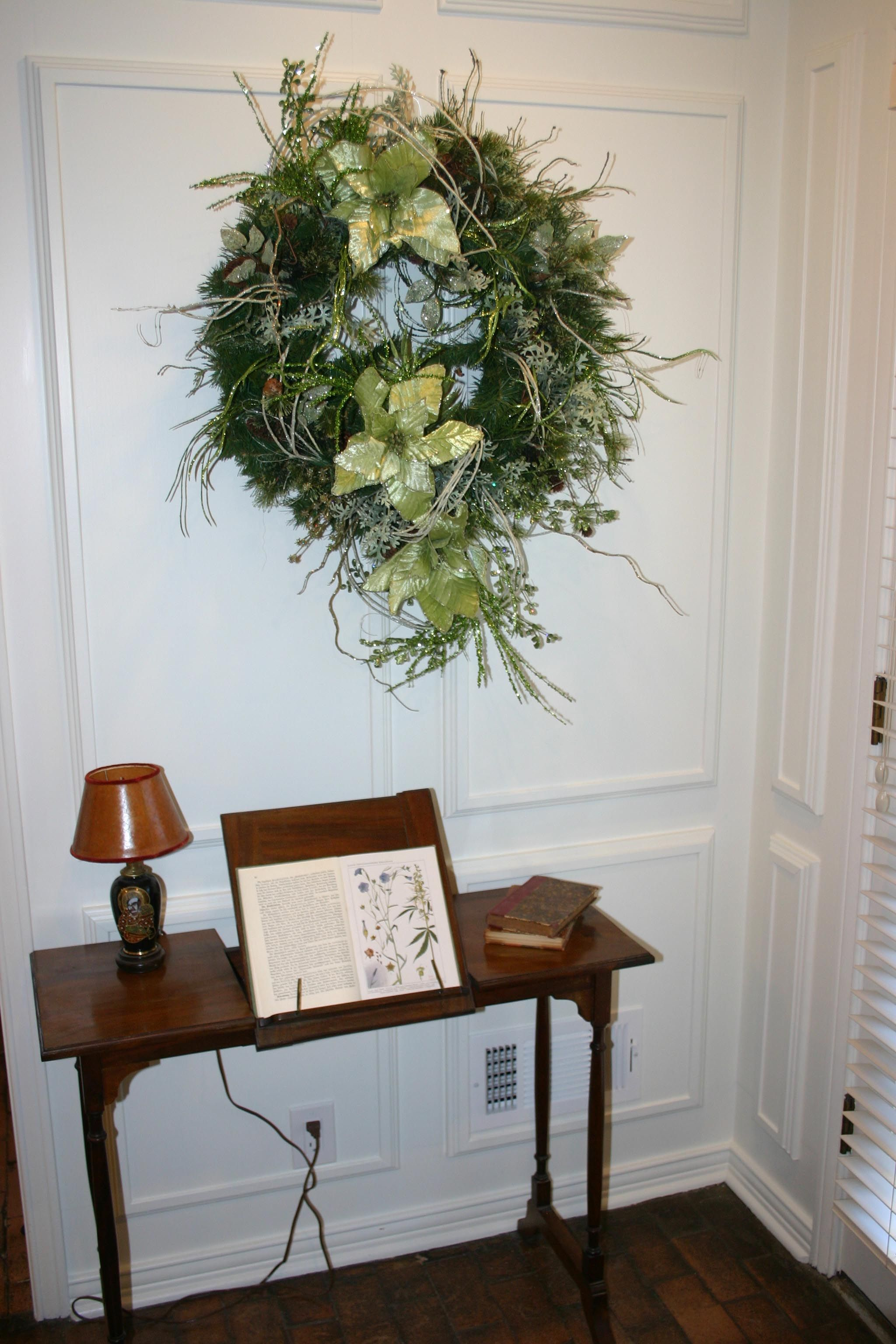 A Wreath With Tail Greens And Silver Lots Of Additions Under It Is My Favorite Small Reading Table Holding An Open Antique Book Botanical