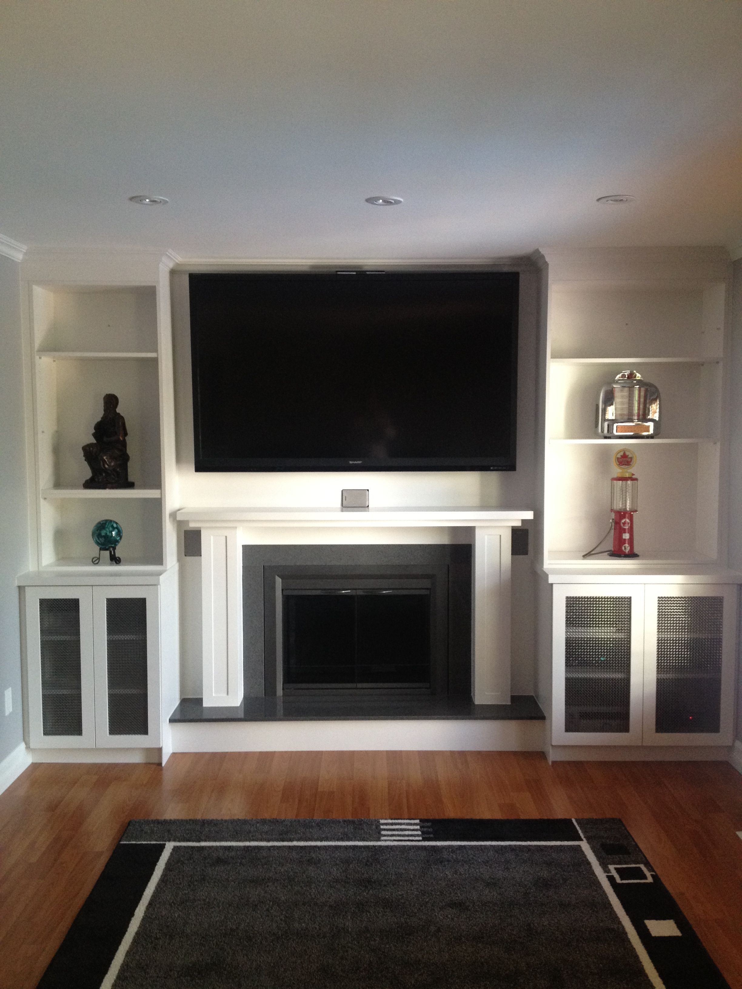 Our project we covered an existing brick fireplace and wall with
