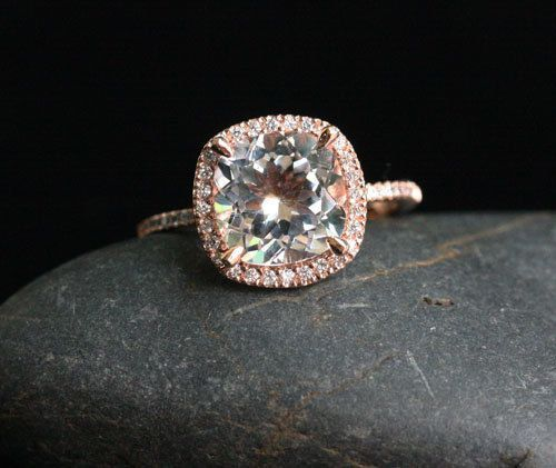 THIS but an oval. rose gold with pink diamonds on the edge and band