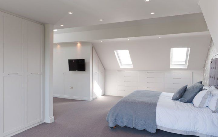 Attic conversion with wardrobes and under eaves drawers for Attic bedroom storage