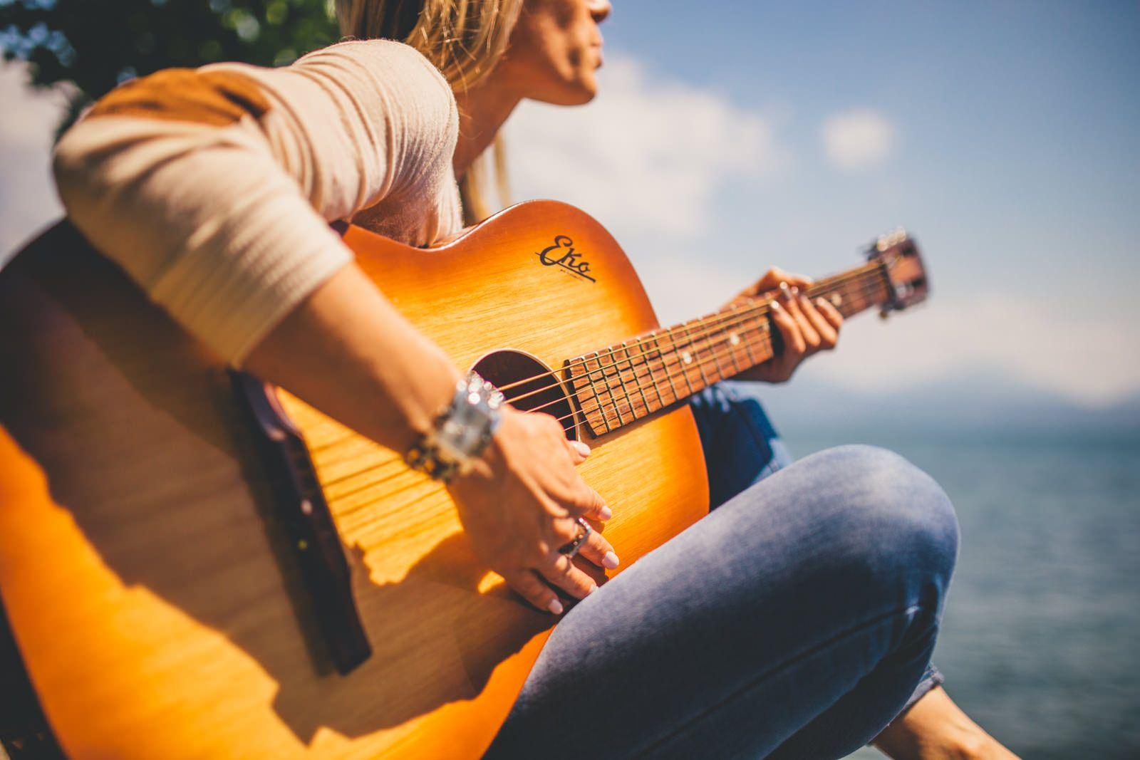Woman playing guitar Music, Good summer songs, Playing