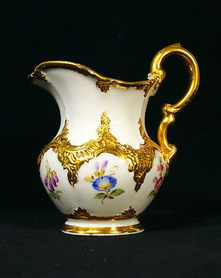 Antique hand painted porcelain creamer with gilded flowers by Meissen, Germany