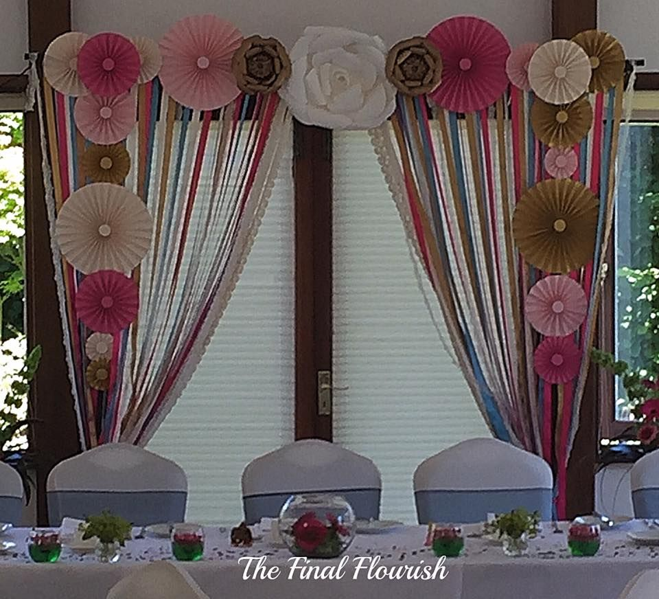 Ribbon Curtains And Co Ordinating Paper Fans Flowers Added Intricate Details That Ed Perfectly With The Brides Decor Available To Hire