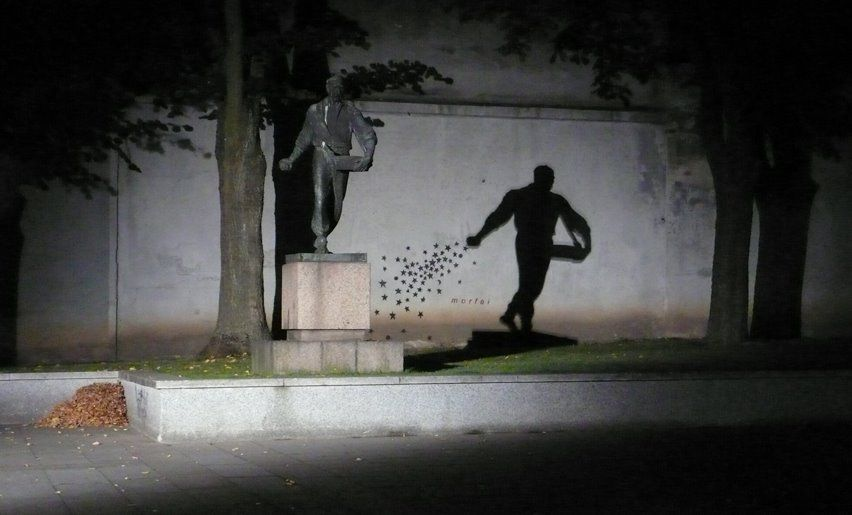 A statue of a man sowing in Book Smugglers Yard (Kaunas, Lithuania). An artist named Morfai had painted stars on the wall behind the statue, in such a manner that the statue's shadow seemed to sow stars.