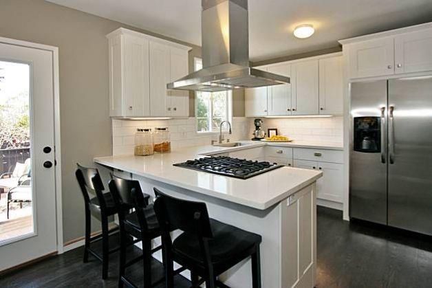 G Shaped Kitchen With Breakfast Bar Next To Door Kitchen Remodel