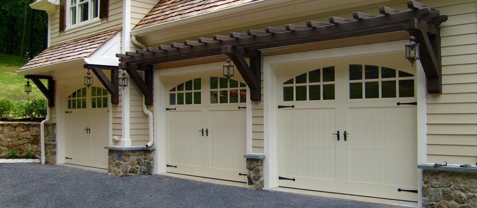 Trellis Over The Garage Doors Carriage House Garage House Exterior Garage Doors