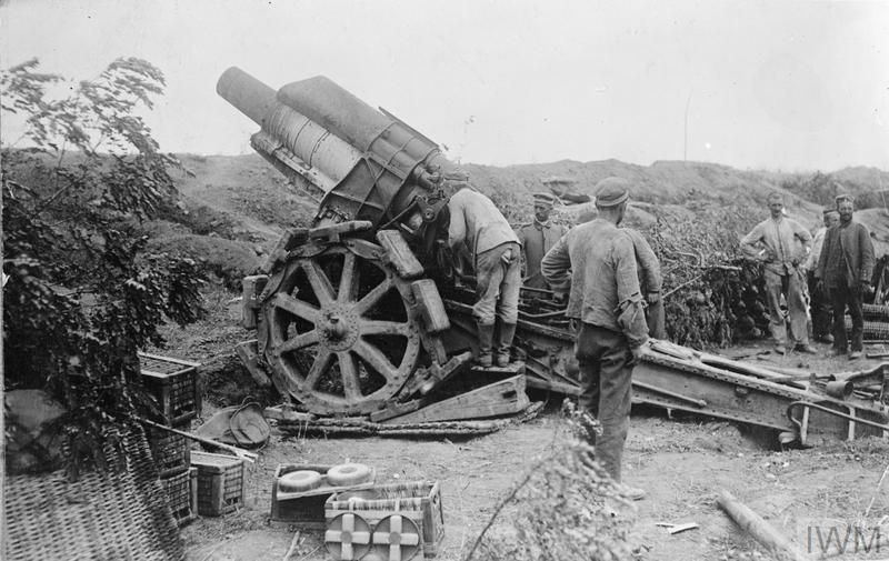 German gunners manning a 21 cm Mörser 16 field howitzer in the ...