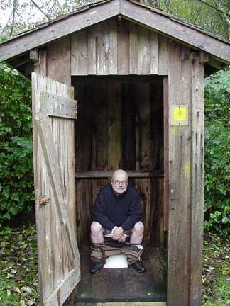 Image result for man in outhouse