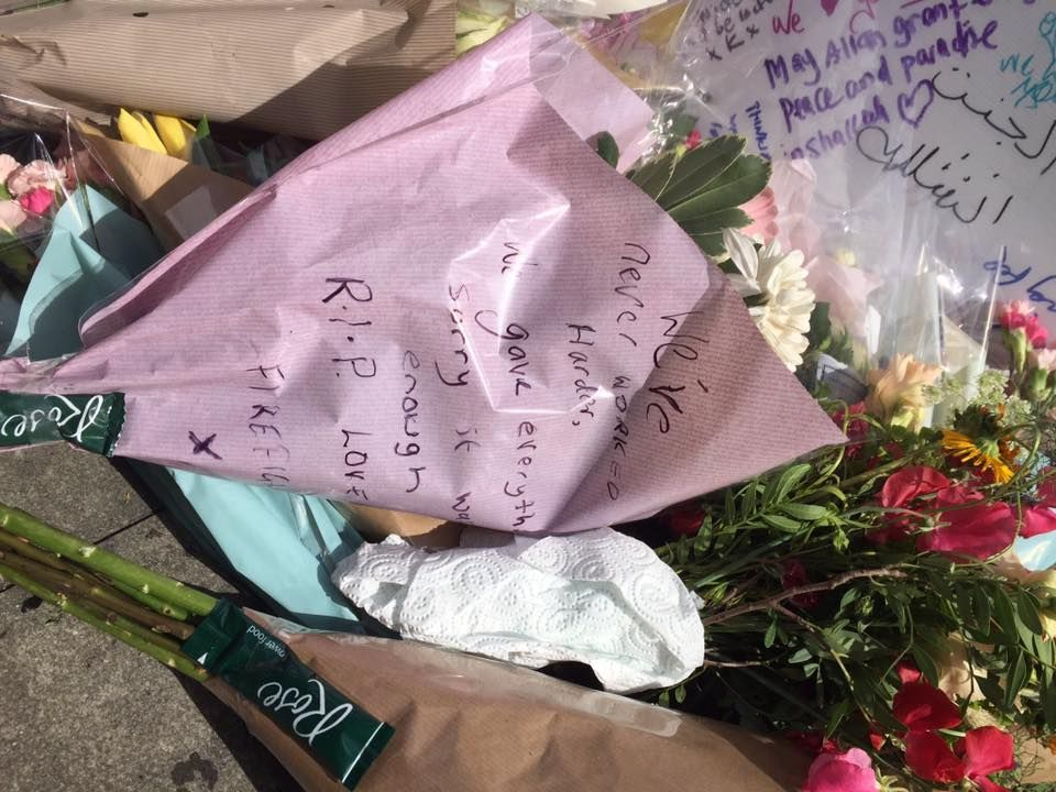 """Left among flowers and memorials for Grenfell Tower Fire:  """"We've never worked harder.  We gave everything.  Sorry it wasn't enough.  R.I.P.  Love, Firefighters  X"""""""