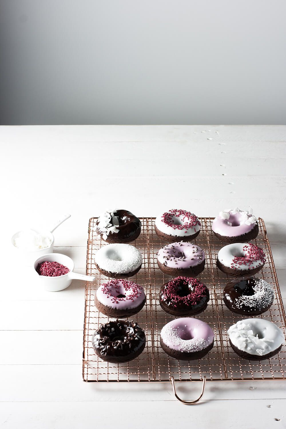 Chocolate cake doughnuts rich in flavor and full of fun! Dipped in all-natural pink glaze, topped with all-natural sprinkles, coconut flakes & cacao nibs.