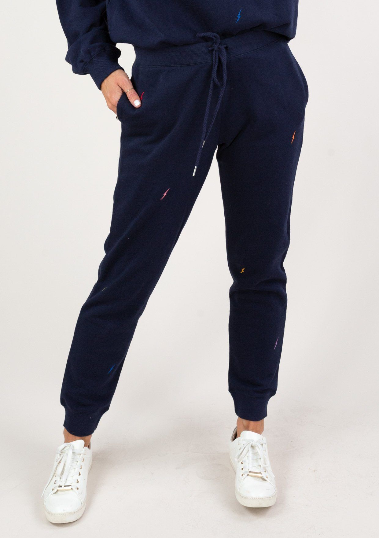 An essential sweatpant with an electrifying twist! Our soft and cozy joggers features a drawstring waistband, side pockets, and playful embroidered lightning bolts throughout. Make it a set with the Lightning Bolt Embroidered Sweatshirt! Embroidered lightning bolt details Relaxed fit Full length Side pockets Drawstring waist Model is 5'9, wearing a size S.Style: I-30142K-RDR