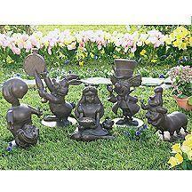 Disney alice in wonderland garden statues outdoor spaces alice in wonderland garden garden for Alice in wonderland garden statues