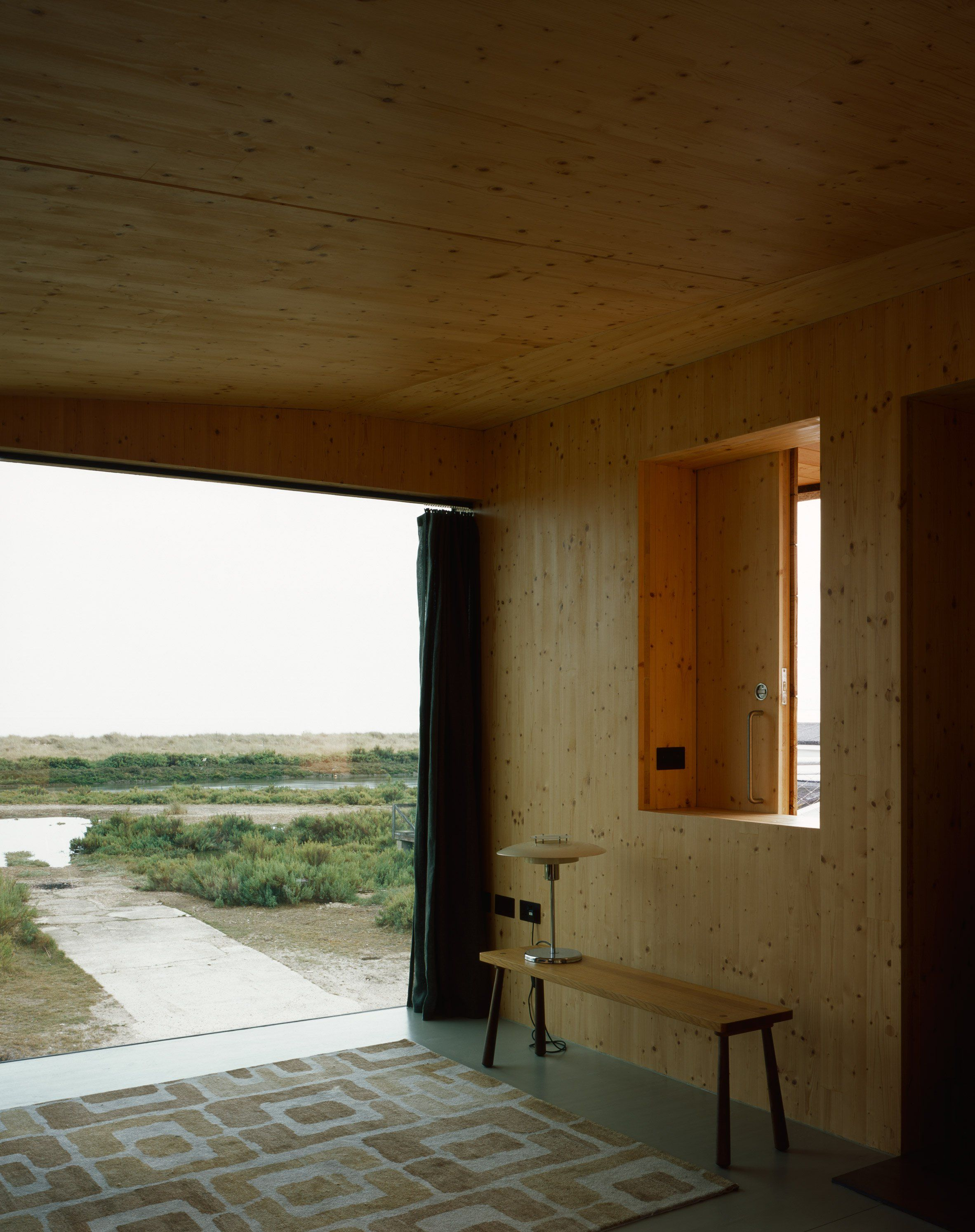 lisa shell designs artists studio as a cork clad cabin raised above a marsh