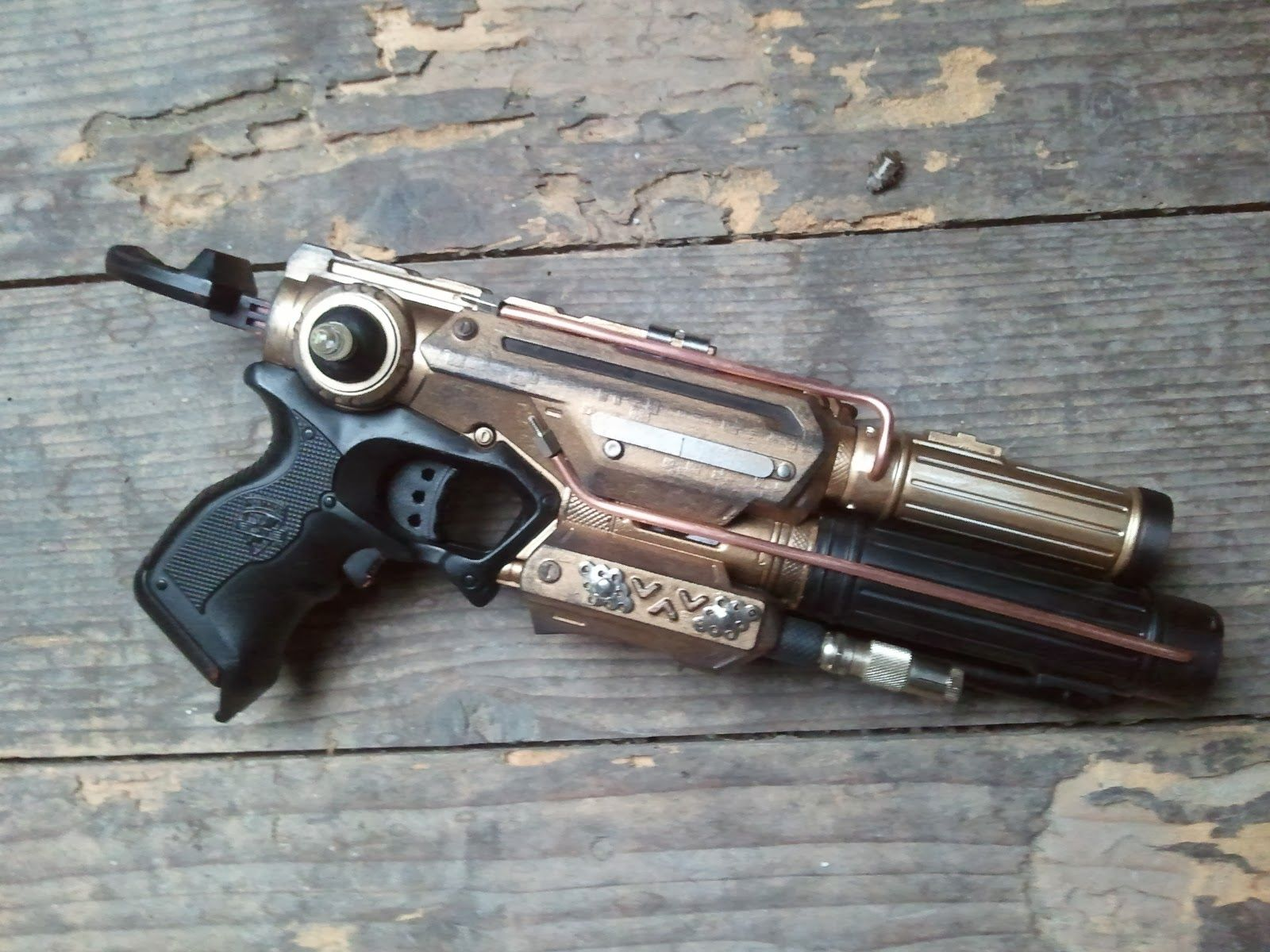Awesome steampunk nerf gun mod, with the bodies of flashlights used to  extend the length