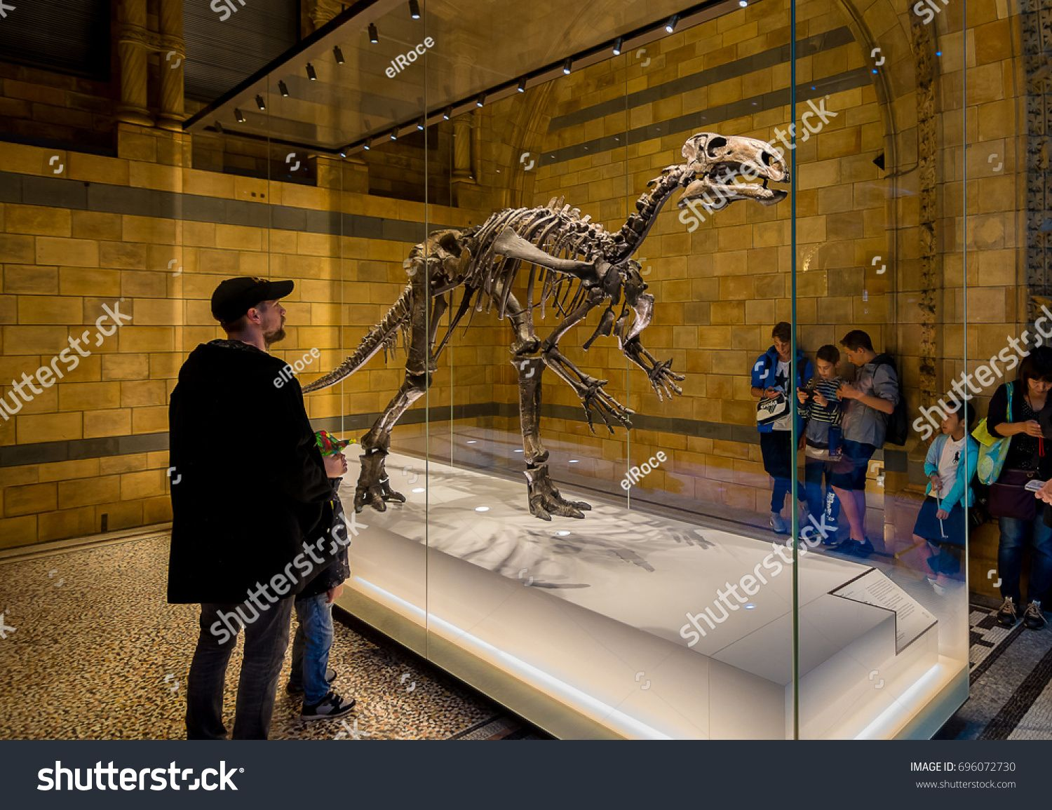 London, United Kingdom. Circa August 2017. Kid and his father watch interested a dinosaur in Natural History Museum of London. #Ad , #sponsored, #August#Kid#Circa#London #historyofdinosaurs