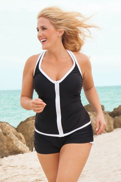 2721761c19469 Get ready for fun in the sun in this scuba inspired plus size swimsuit with  shorts by Always For Me Sport! Full coverage