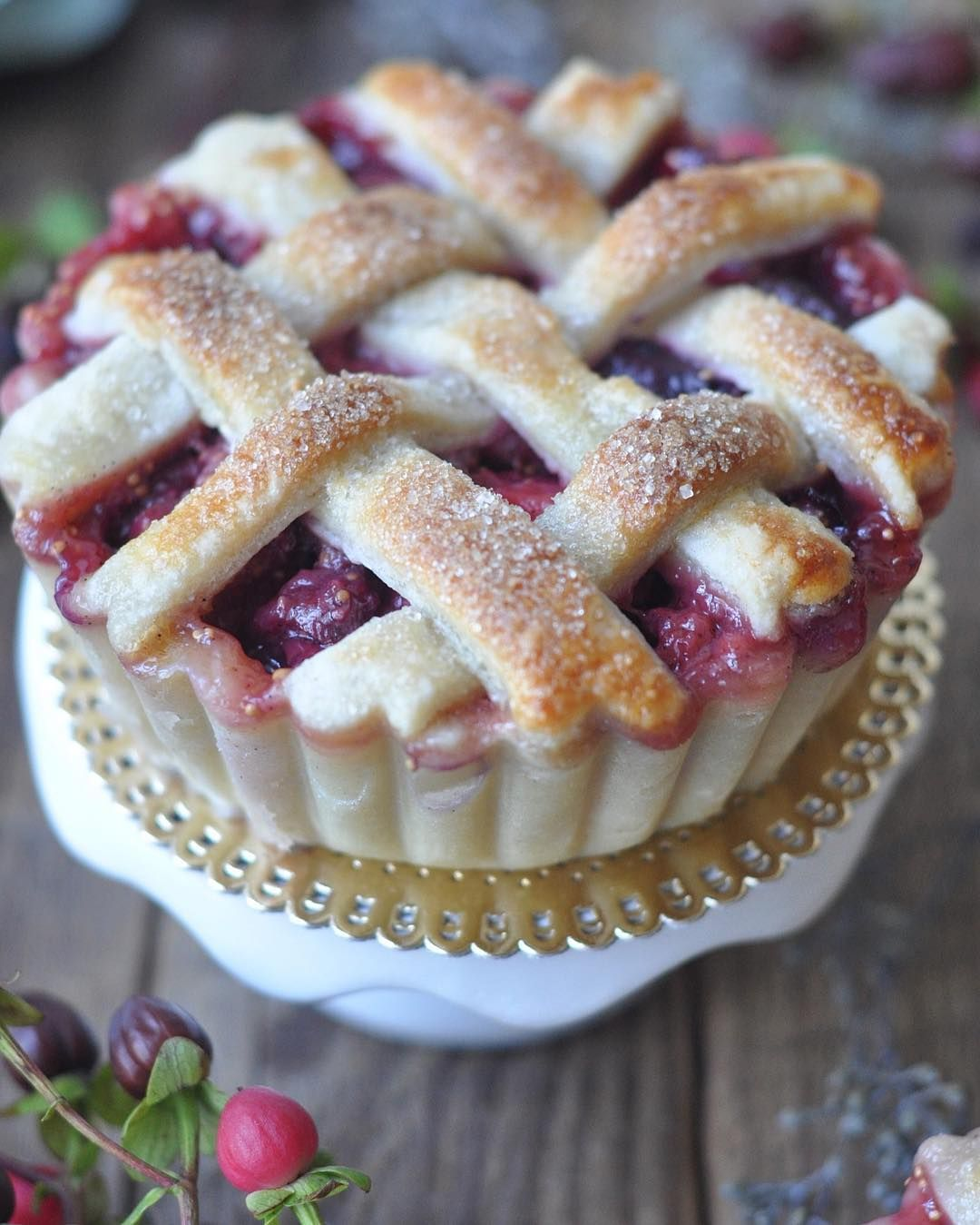 Up close and personal with this strawberry-fig pie. . . . .  #strawberryfigpies #strawberrydesserts #figs #pies #pie #piecrust #latticepie #lattice #latticework #desserts