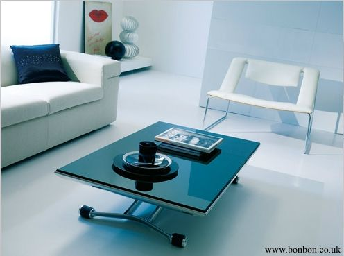 Rises up like an ironing board extends Space saving table Magic
