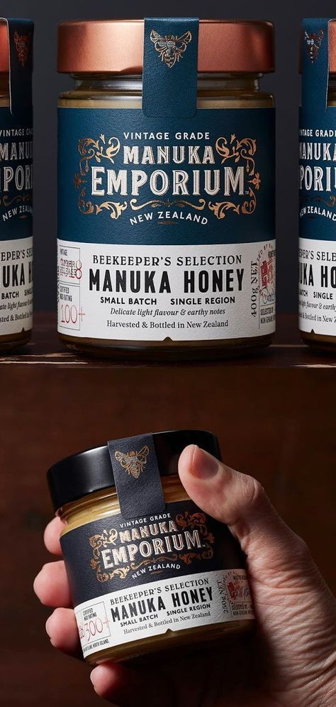 Manuka Emporium  Beekeeper's Selection Manuka Honey is part of Honey packaging, Honey label design, Honey brand, Bee keeping, Food branding, Honey design -  Materials Glass jar Printing Process Offset, foil stamping In today's world of fast moving consumer goods, honey is often mass produced in bulk to meet demand, blended with varieties from numerous regions which dilutes the true provenance, character and flavour of the core ingredient  Manuka Emporium is a new honey brand challenging this mentality  Working with a select group of today's apiarists in New Zealand, Manuka Emporium were inspired by the attitude, persistence and honey making philosophies of those who have come before and focused on delivering a product that is truly special in the market  The beekeepers from yesteryear harvested and sold pure single source honey to their local general stores which was then bottled and labelled by the shopkeeper  Simple, honest and true  The brief was to create a superior brand that echoed the values of these skills and create an compelling visual language that would appeal to the discerning consumer looking for that special item for a social occasion or gifting  Inspired by the authenticity, opulent decoration and typographic crafting of premium liquor brands that can be discovered in old whisky lounges and bars, the brand exudes the charm and character of a Victorian era shop  Product details were added with the Beekeepers Selection label, proudly displaying vintage, season, style, flavour notes and the apiarists signature  Copper foiling, red stamps, different colour labels denoting MGO strength and a unique bee motif add premium cues to the quality of the product  The Beekeepers Selection is the purest of foods, gifted by nature