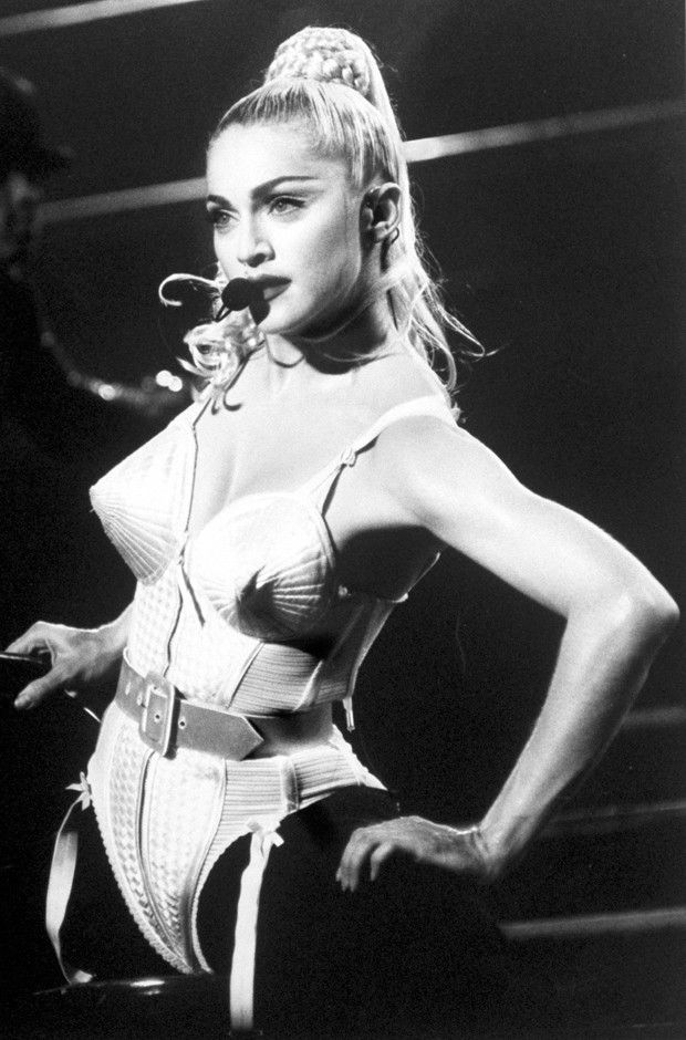 Madonna on stage on her iconic Jean-Paul Gaultier designed corset and girdle during her 1990 Blonde Ambition Tour.
