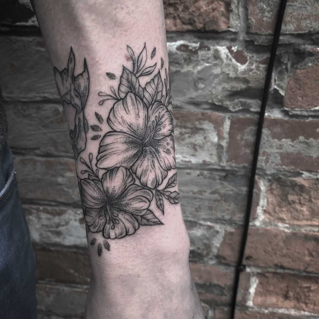 Wrapping Blackwork Hibiscus Tattoo Wrapped Around The Left Forearm