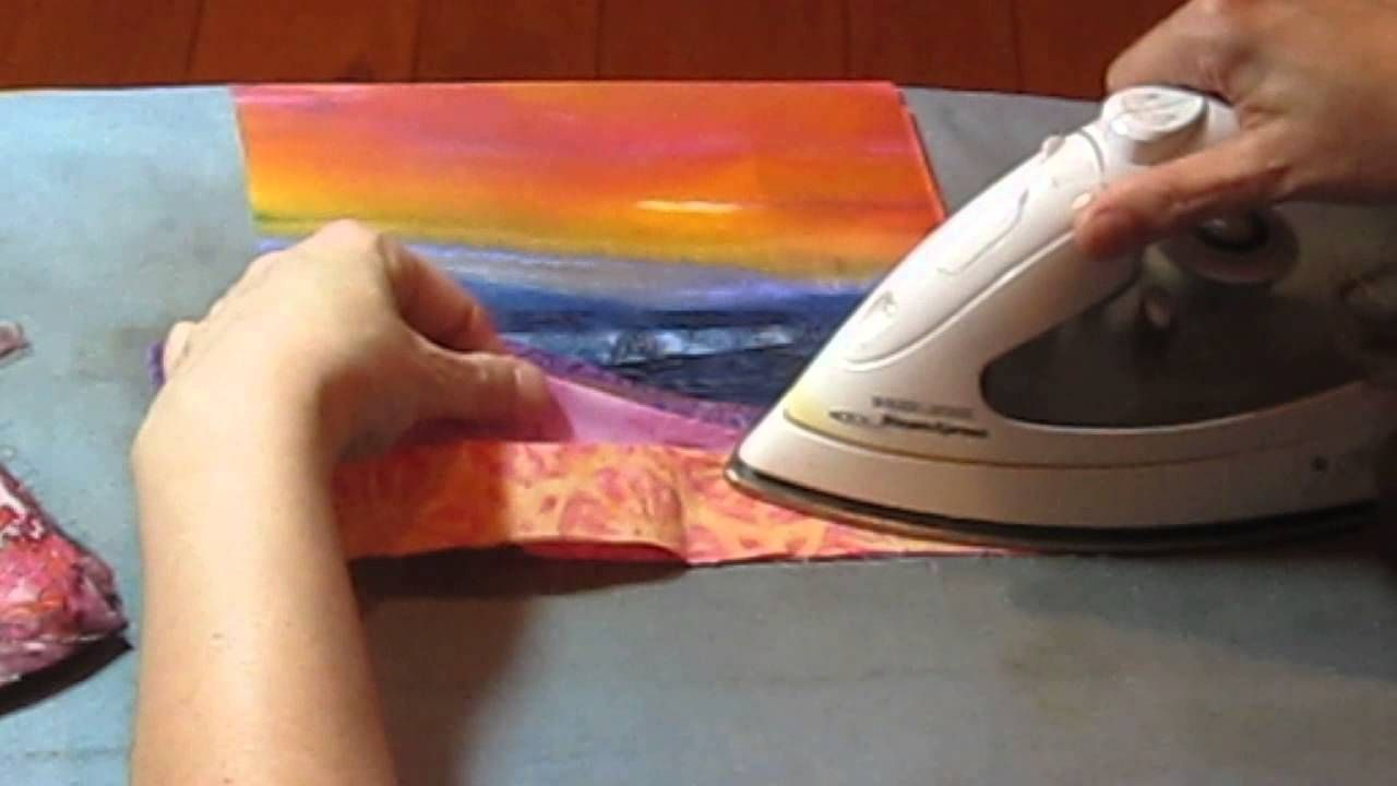 Nathalie designs a landscape quilt and demonstrates how to cut, press and section the fabrics.