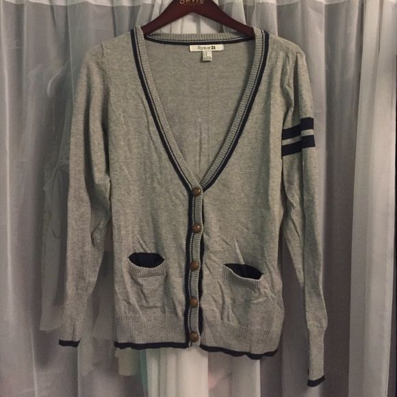Prep School Cardigan This preppy gray sweater has navy blue accents including soft elbow pads. The buttons are very ornate. Sleeves are full-length. It has only been worn once! Forever 21 Sweaters Cardigans