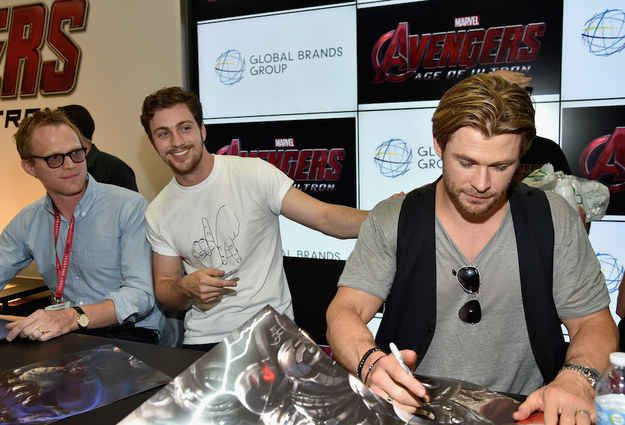 Aaron Taylor-Johnson and Paul Bettany may be new to The Avengers cast, but they at least know better than to get near Hemsworth's arms. | Chris Hemsworth Flexes Biceps, Humiliates The Avengers