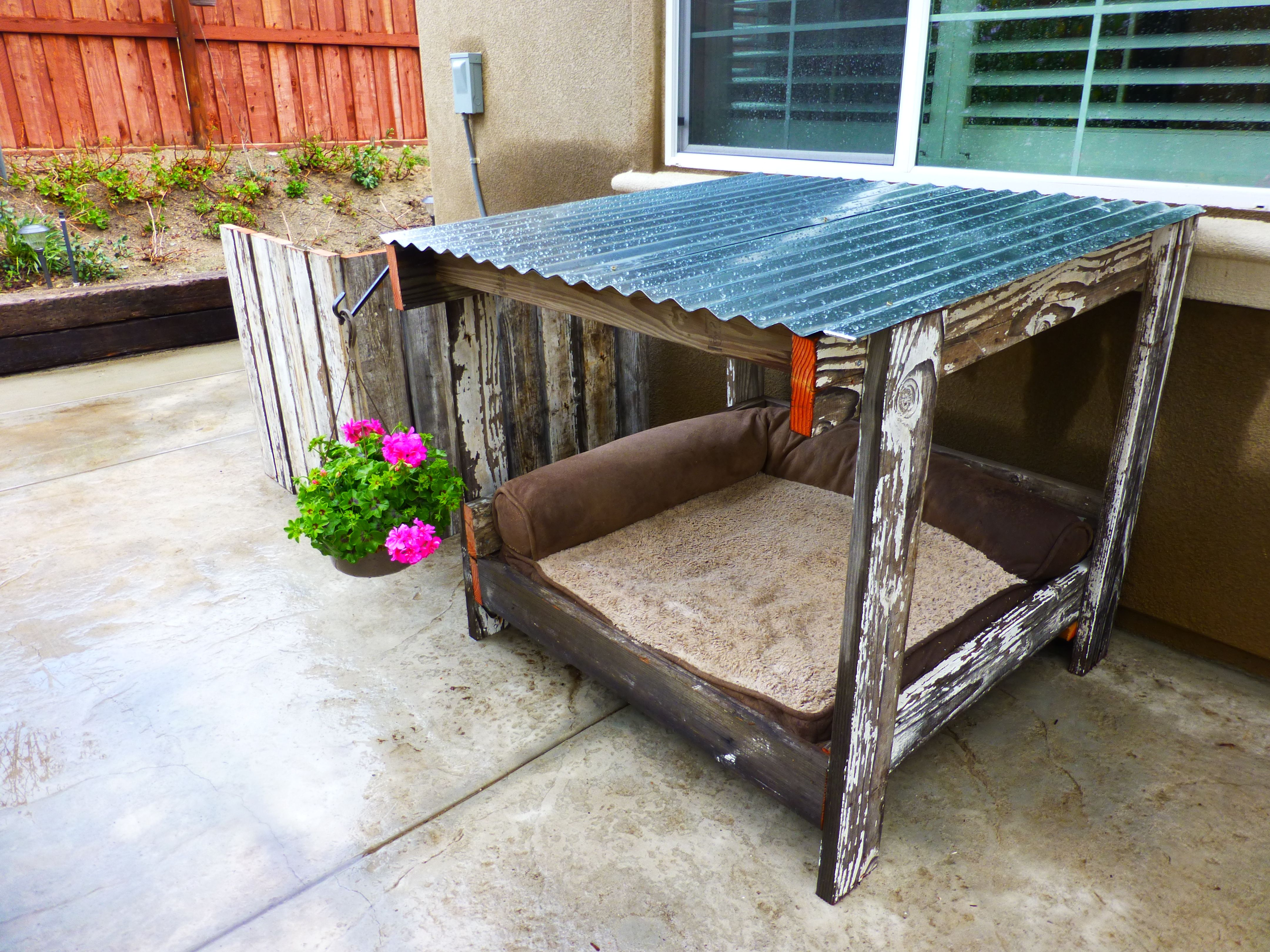 Dog house old fence wood and a pallet = dog house a c cover and