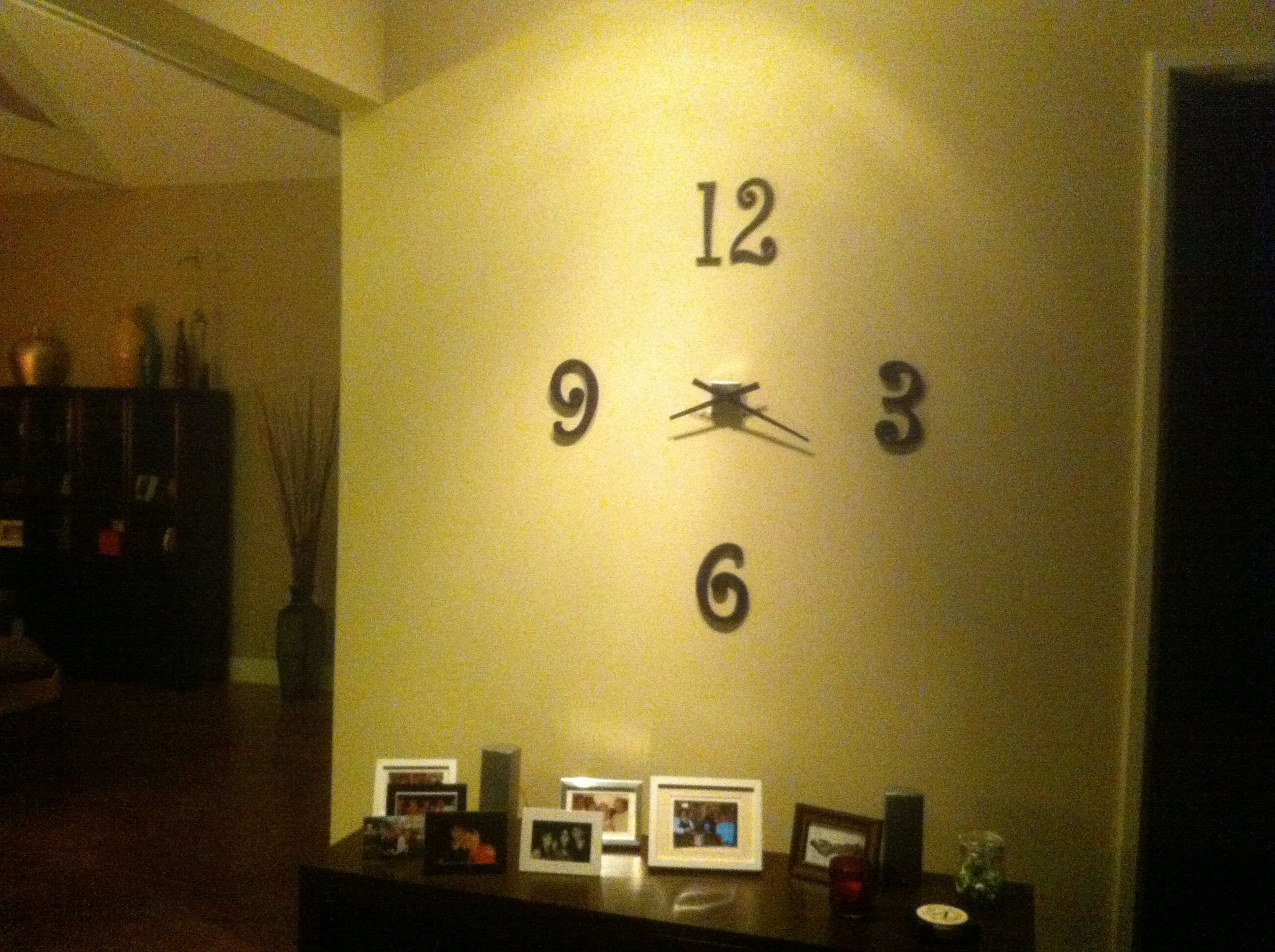 Homemade wall clock made of crafted numbers and a recycled clock ...
