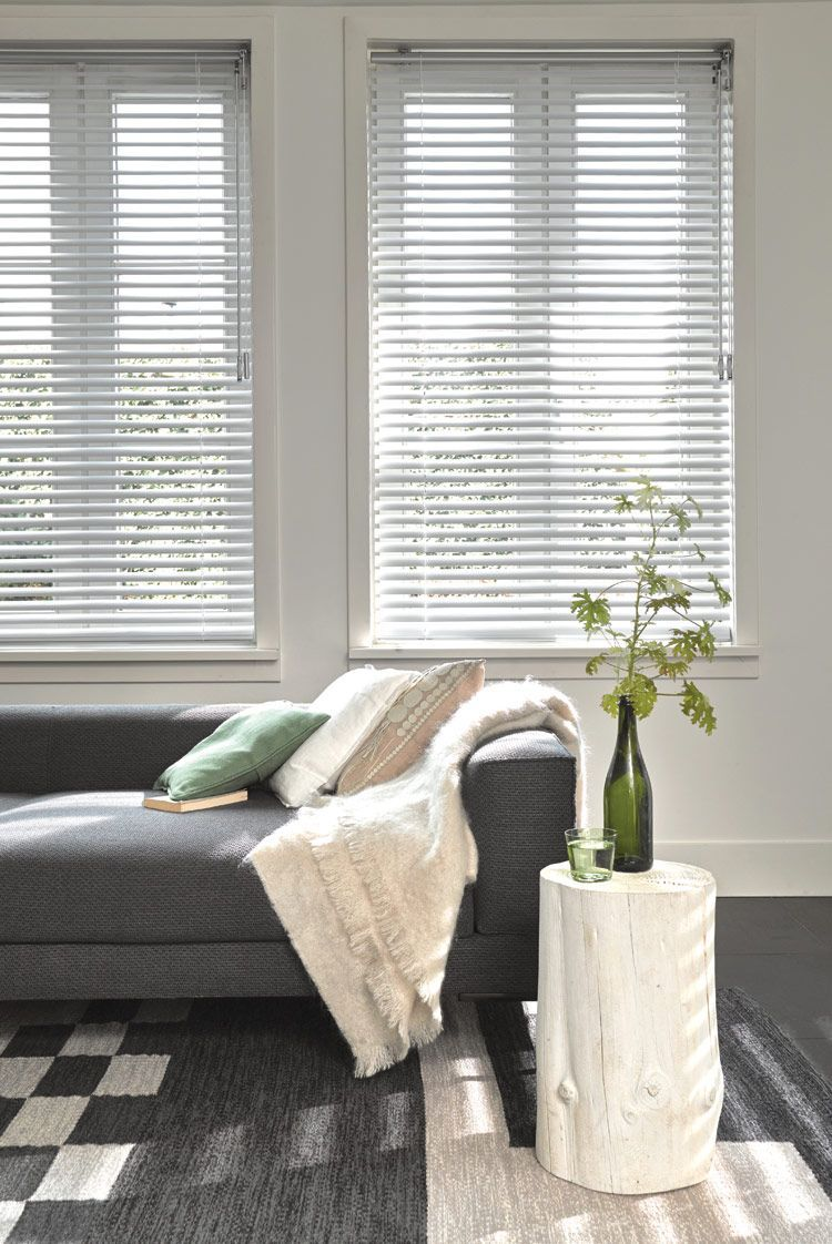 Cosy living room with green accessories and Luxaflex Venetian blinds ...