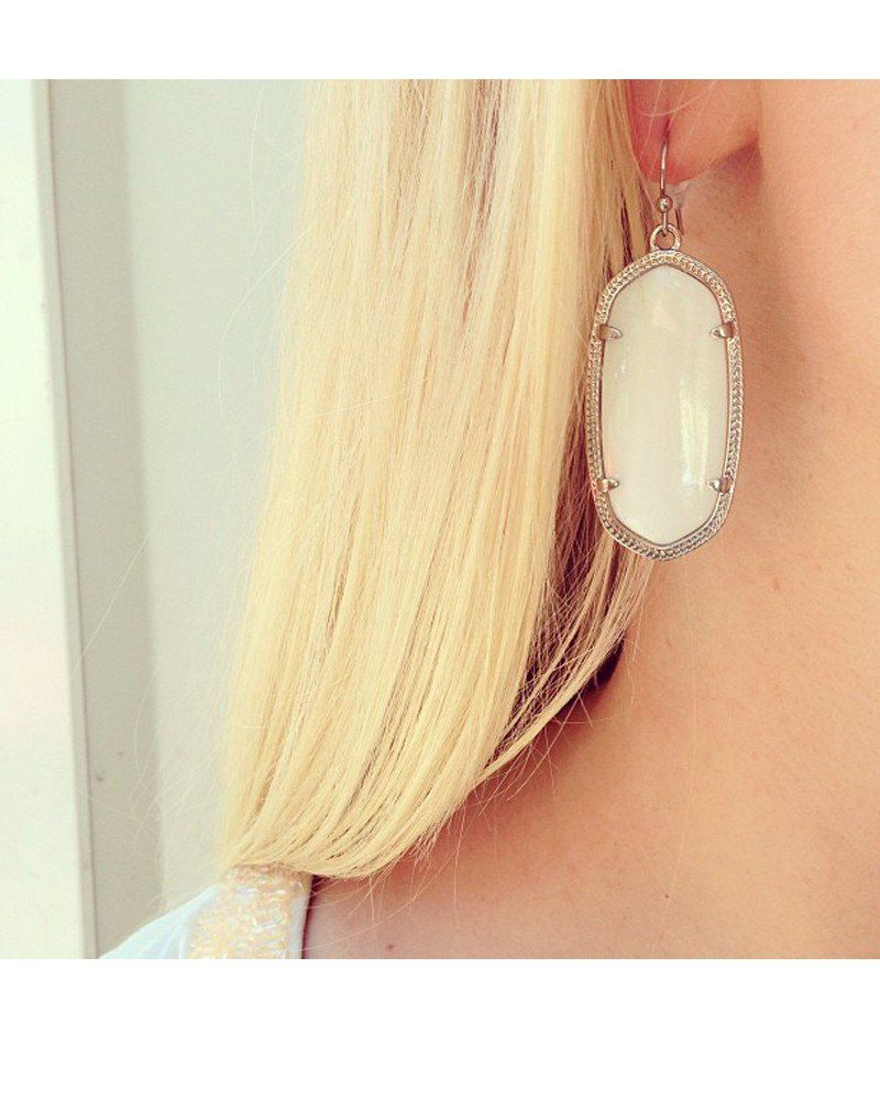e80488af5 White mother-of-pearl is a popular, classic color here at Kendra Scott. Our Elle  Earrings encompass this stone in an oval, rhodium silver plating for a ...
