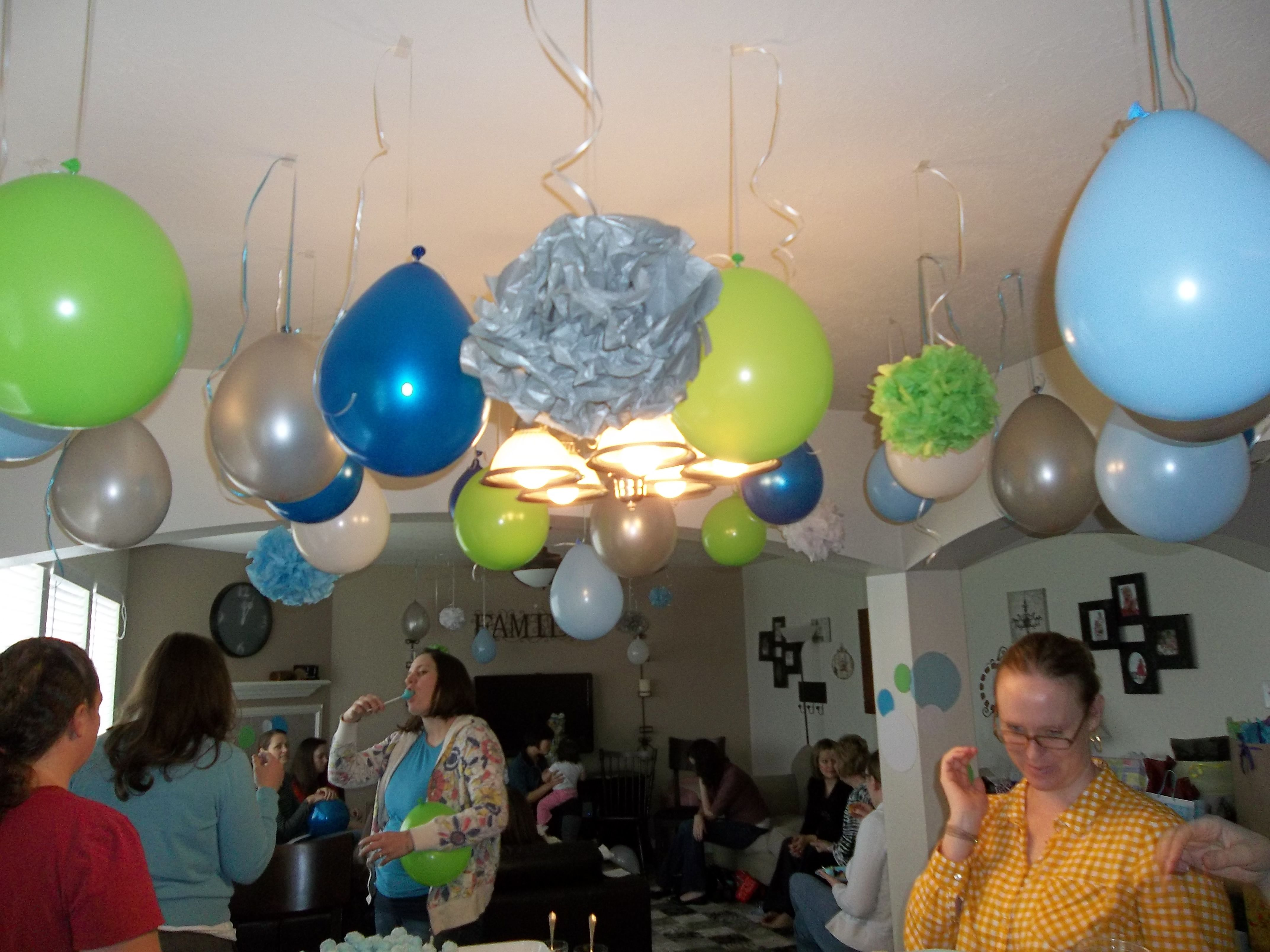 home made pom poms, and hanging balloons upside down with marble inside!