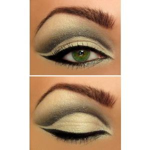 Green and black cat lined smokey eye.