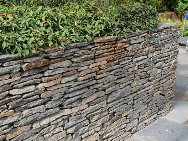Thin Ledge Stacked Stone Wall Michaelmuro Com Sloped Garden Stacked Stone Walls Waterfalls Backyard