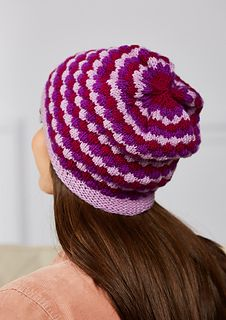 This slightly slouchy hat is worked in the round in an easy-to-knit textured pattern. Only one colour is used at a time. Interlocking diamonds are created in wide stripes of colour with a tuck stitch knit into a stitch several rounds below the needle while releasing the stitches above.